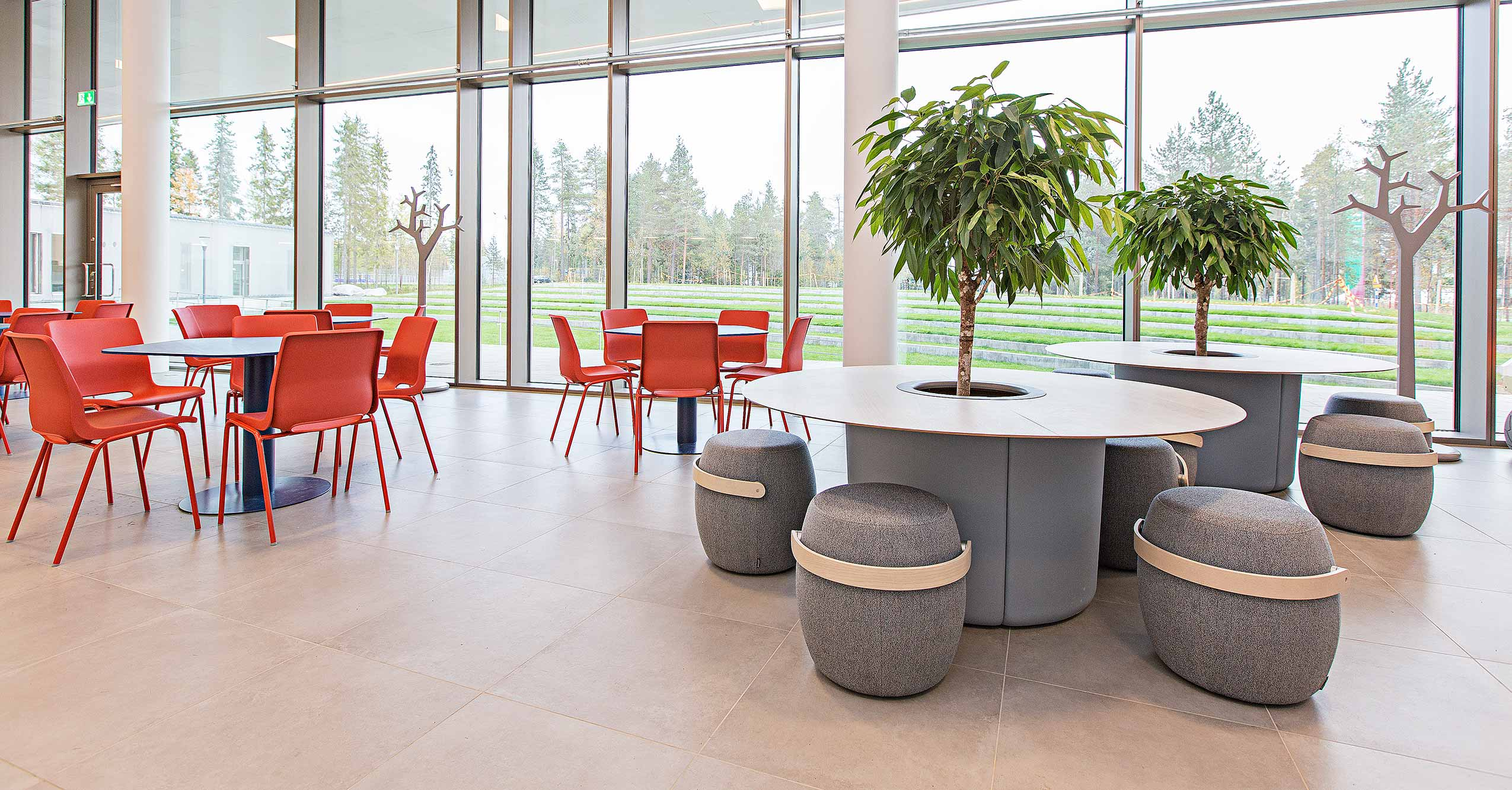 RBM Ana red canteen and cafeteria chairs with grey stools and round table with tree in high school