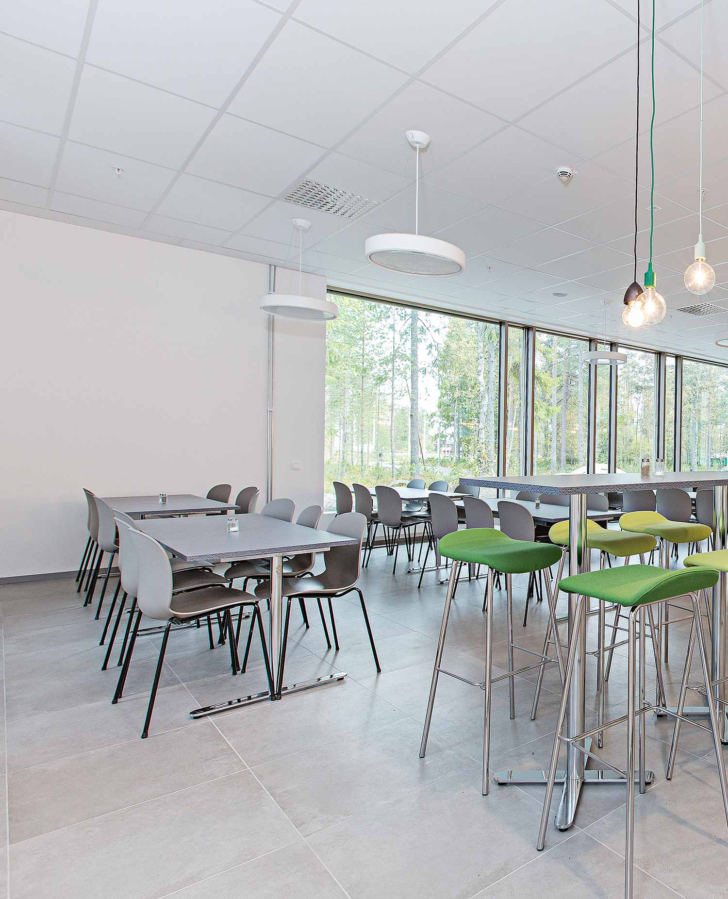 Light grey RBM Noor chairs in Minerva High School social area for eating