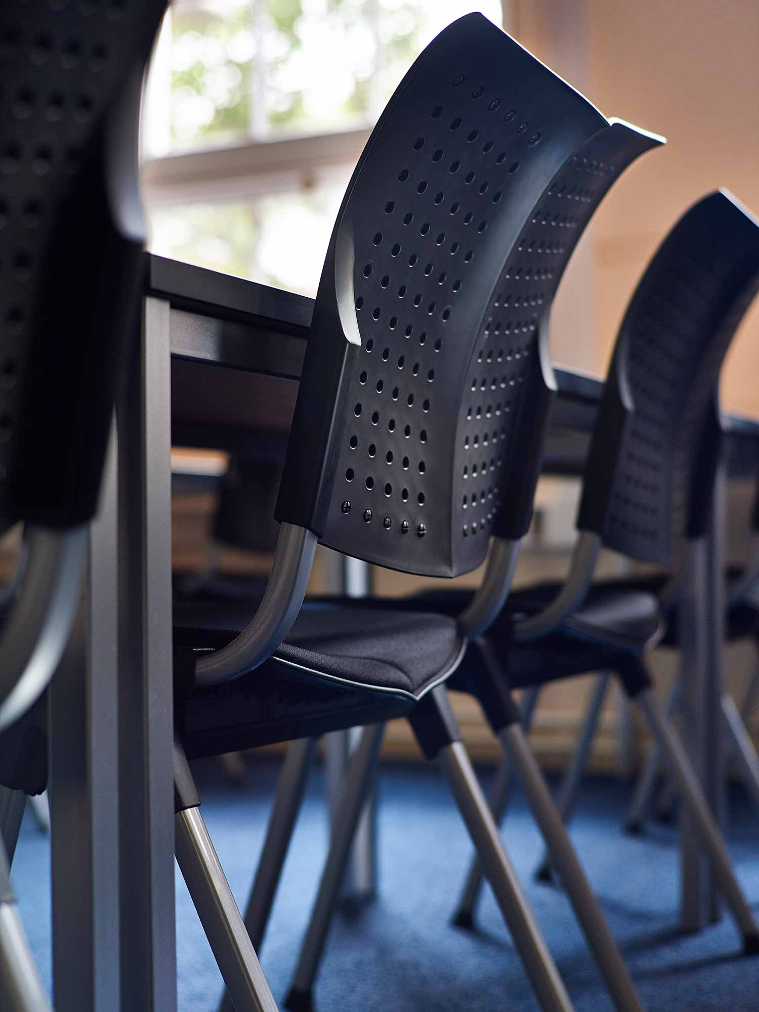 Close up photo of HÅG Convention Wing in black in classroom